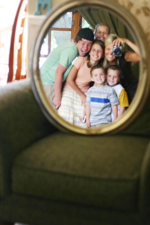 Take picture of self & kids w/ a cool mirror