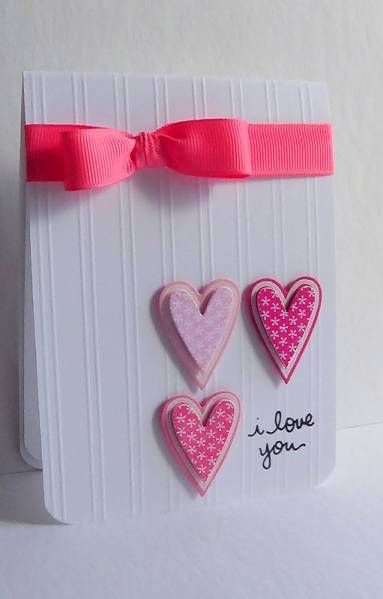 sweet handmade Valentine card ... clean and simple design ... like the popped hearts in a four square with the sentiment as one of the four and the embossing lines on the card face ...