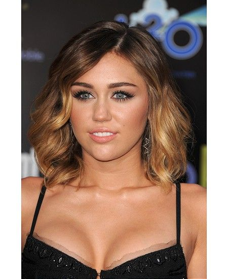 I love Miley Cyrus what happened to her I mean she is very pretty but what happend she changed a lot am I right?????????????????????