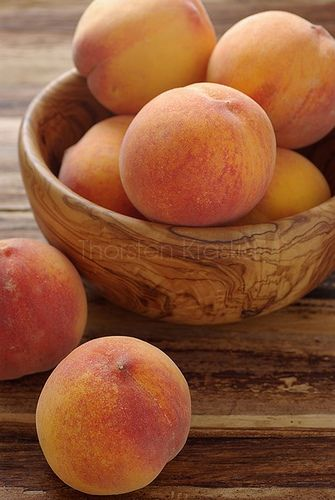 peaches in a wooden bowl