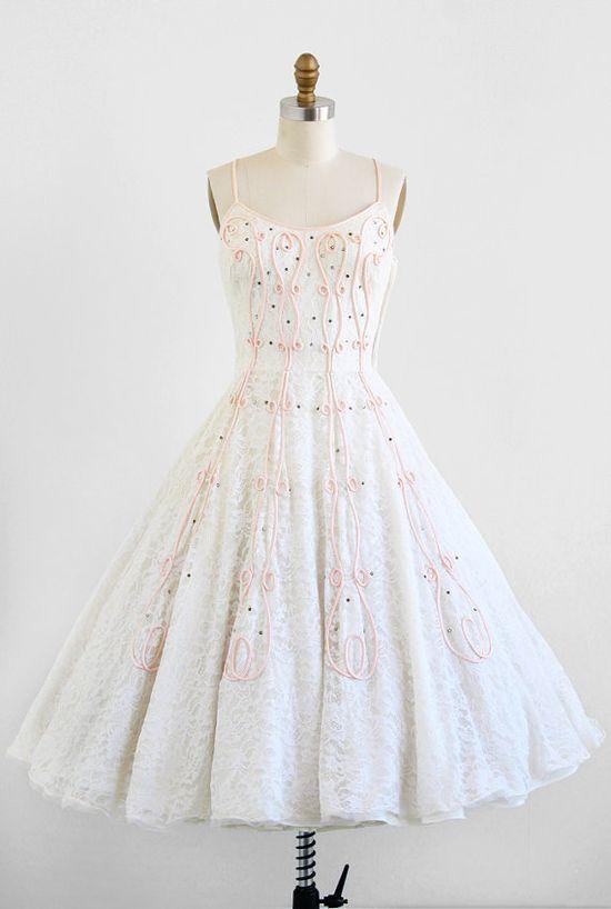 vintage 1950s wedding dress with pink cupcake frosting swirls