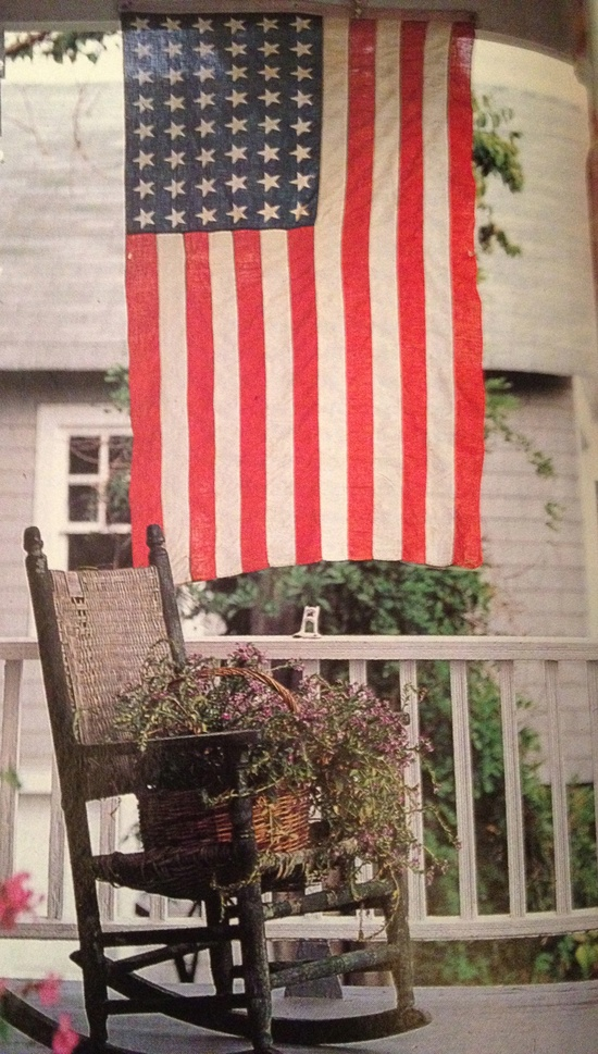 Americana Porch...old rocker with...basket & flower...flag.