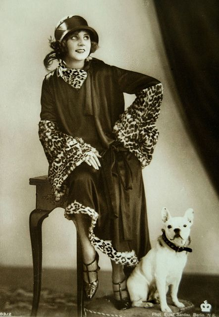 German silent film actress Ossi Oswalda (and an adorable canine companion) in the 1920s