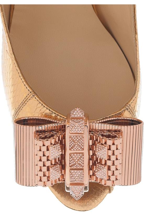 Christian Louboutin heels.