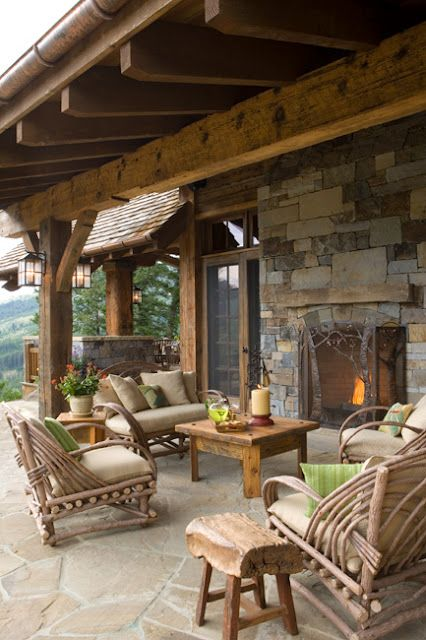 Outdoor living area - I like the rustic-but-comfortable feel.  And check out that fire place.
