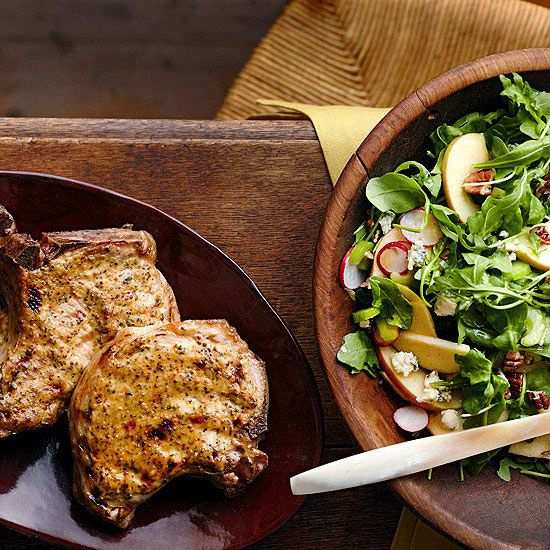 These Dijon Pork Chops with Apple Salad are bursting with flavor! More grilling recipes: www.bhg.com/...