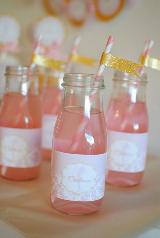 Pink and Gold bottles of lemonade with striped straws