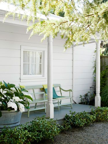Love this porch - 'Blushing Bride' hydrangeas bloom in a galvanized tub on this guesthouse #porch.