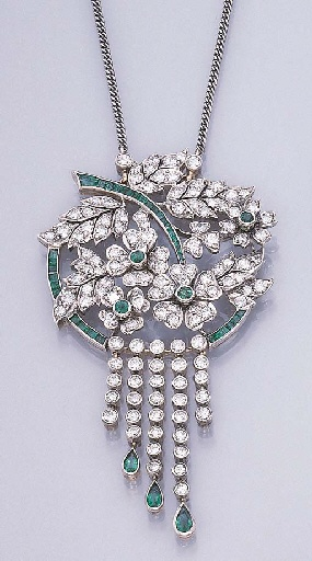 A DIAMOND AND EMERALD PENDENT NECKLET   The pendant designed as a bouquet of circular-cut diamond clovers and leaves, with collet and calibré-cut emerald detail, suspending a staggered fringe of collet diamonds, with pear-shaped emerald terminals, to the fine-link neckchain (neckchain adjustable), circa 1935, 44.0 cm., in a purple velvet fitted case
