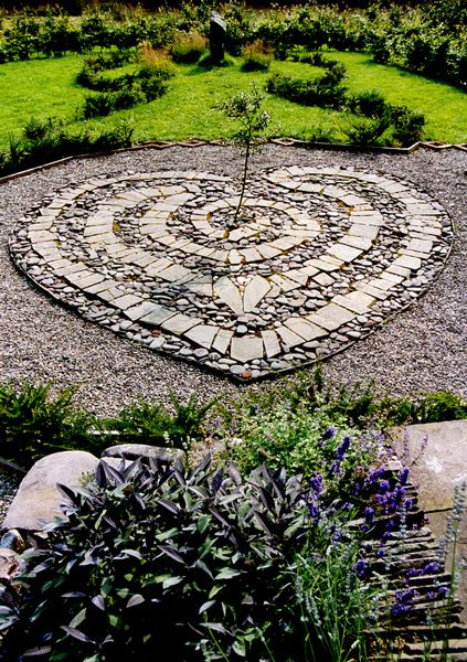 heart mosaic in garden path
