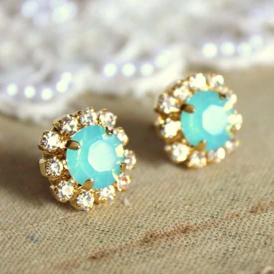 Gold studs with turquoise stones.
