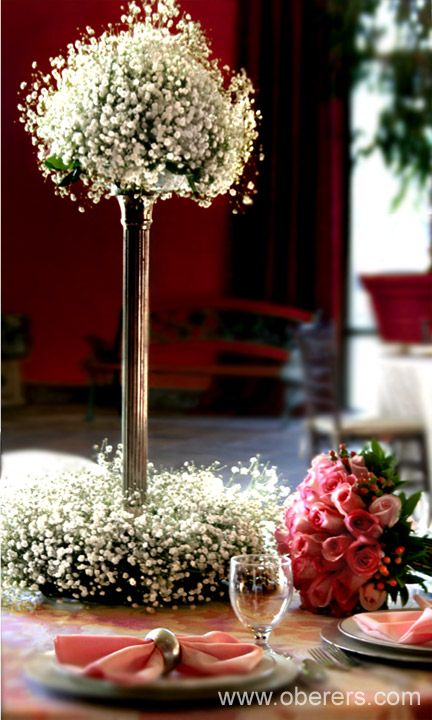 Two Tiered Baby's Breath Tall reception wedding flowers,  wedding decor, wedding flower centerpiece, wedding flower arrangement, add pic source on comment and we will update it. www.myfloweraffai... can create this beautiful wedding flower look.