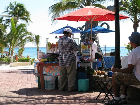 Fresh fruit vendors (mango, watermelon, coconut, jicama and pineapple) at the square in Playa del Carmen.