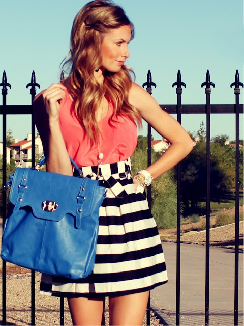 Interesting outfit.. Pretty hair, striped skirt, and large blue bag.