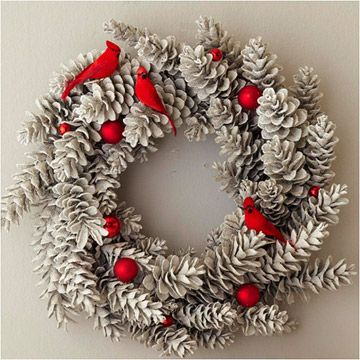 Pinecone Wreath with Cardinals and Ornaments     This pinecone wreath will sparkle and pop with color after a few simple additions. To make, coat a store-bought pinecone wreath with gray spray paint. Spray with spray snow, then silver glitter, allowing drying time between coats. Arrange three cardinal figurines and nine round red ornaments among the pinecones, adhering with hot glue to keep them in place.