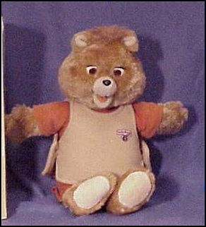 Teddy Ruxpin- the story telling bear-----My daughter had one until she threw him down a flight of stairs and broke his damn neck!! Thing was wobblin' all around!!! :0)