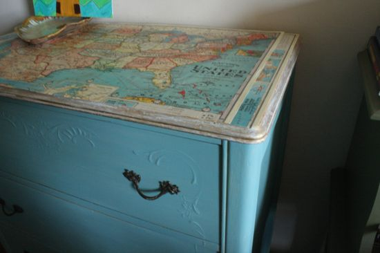 Mod Podge maps to the top of a dresser