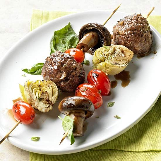These savory kabobs get their flavor from fontina cheese-stuffed meatballs and fresh veggies. Recipe: www.bhg.com/...