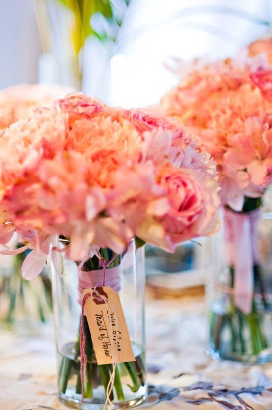 Coral-colored wedding bouquets @Jenny Pfeiffer @Jennifer Milsaps L Blersch ?