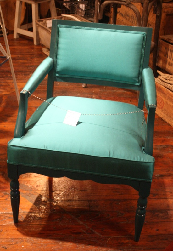 High Point Fall 2011-Estate Design and Trade- Market Square  Loved this antique chair reimagined in green upholstery and paint- very chic!  #hpmkt