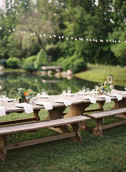 Bench seating & string lights for a garden party delight.
