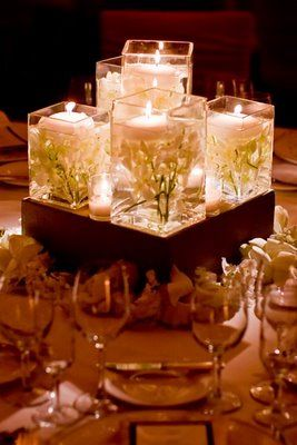 submerged flowers + floating candles + square vases