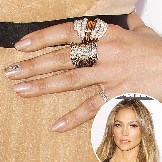 Jennifer Lopez: For Celebrity Fight Night, Jennifer Lopezs manicure pick was a shimmering nude shade, but she added drama with a few studs on the accent nail.