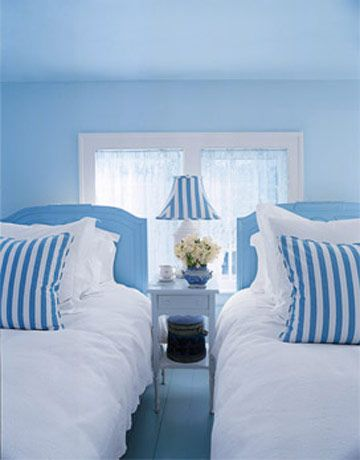 A Clean and Crisp Guest Room  Designer Valerie Smith used antique oversized twin beds for this guest bedroom. The blue and white palette creates a crisp and simple look.