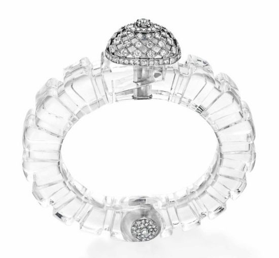 AN ART DECO DIAMOND AND ROCK CRYSTAL BANGLE BRACELET, BY CARTIER