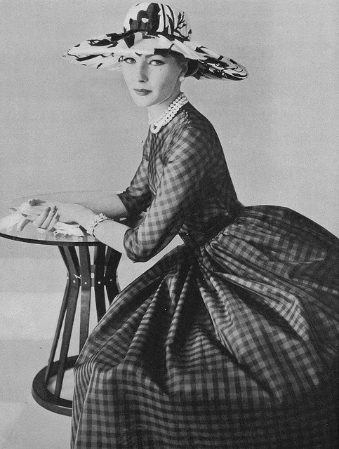 Classic beautiful dark gingham modeled by Jessica Ford for Vogue magazine, May 1957. #dress #vintage #fashion #1950s #hat