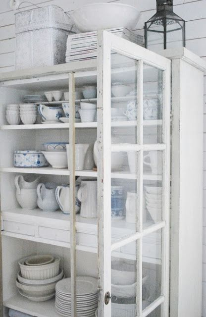 white beach cottage walls, white cabinet