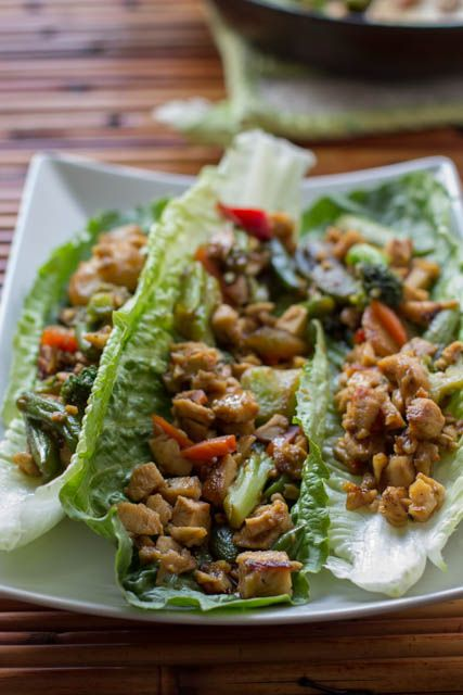 Asian Lettuce Boats loaded with delicious veggies and chicken thats ready in less than 30 minutes and as good as your favorite takeout! ohsweetbasil.com