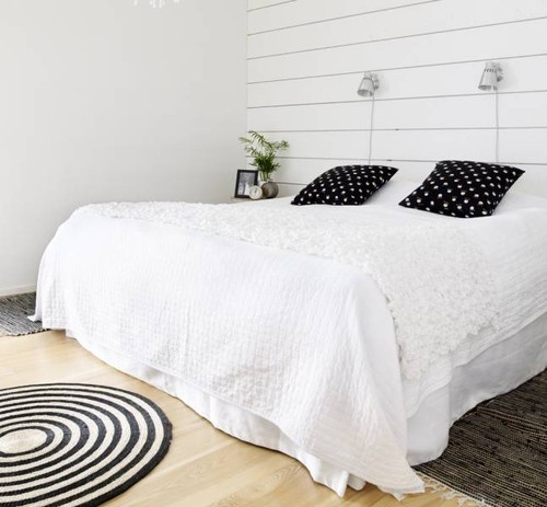 White bedroom with black accents.