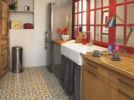Unique small kitchen with red and grey.
