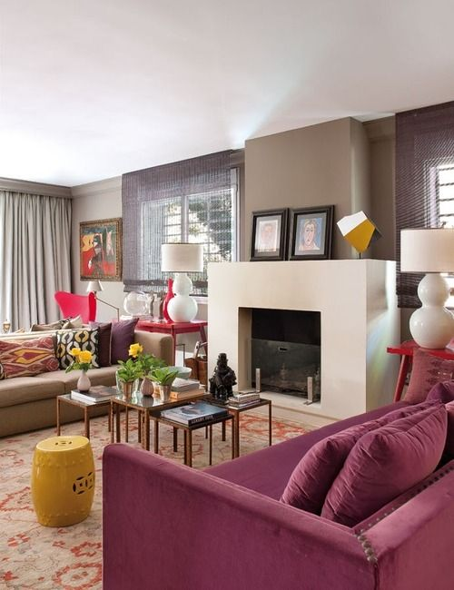 I love the incorporation of the color ( but never a purple couch ever.) I like the wall color too.