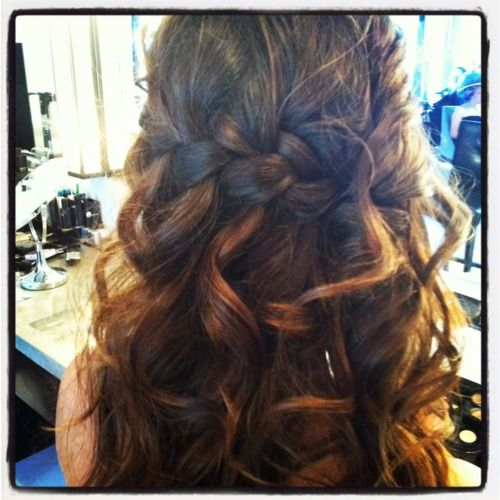 Almost perfect... half up, half down style with curls and a braid. I would just add in some flowers...