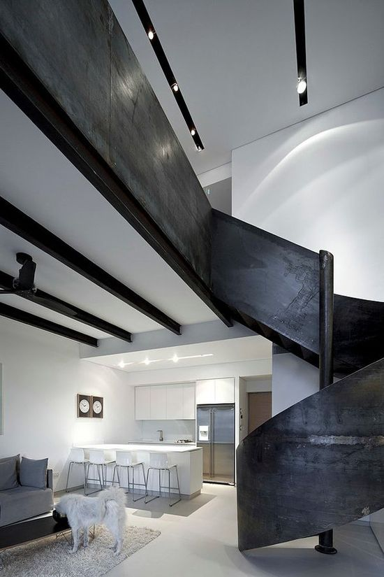 Modern apartment with a sleek sculptural staircase