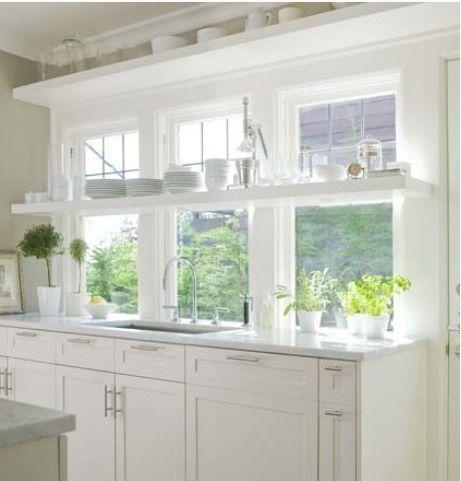 white kitchen w/ open shelving across window