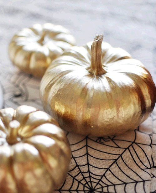 Gold painted mini pumpkins.