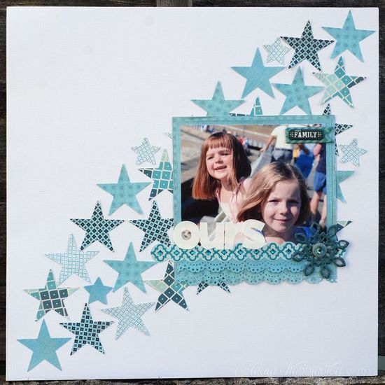 Love the stars and how they draw the eye through this scrapbook page layout