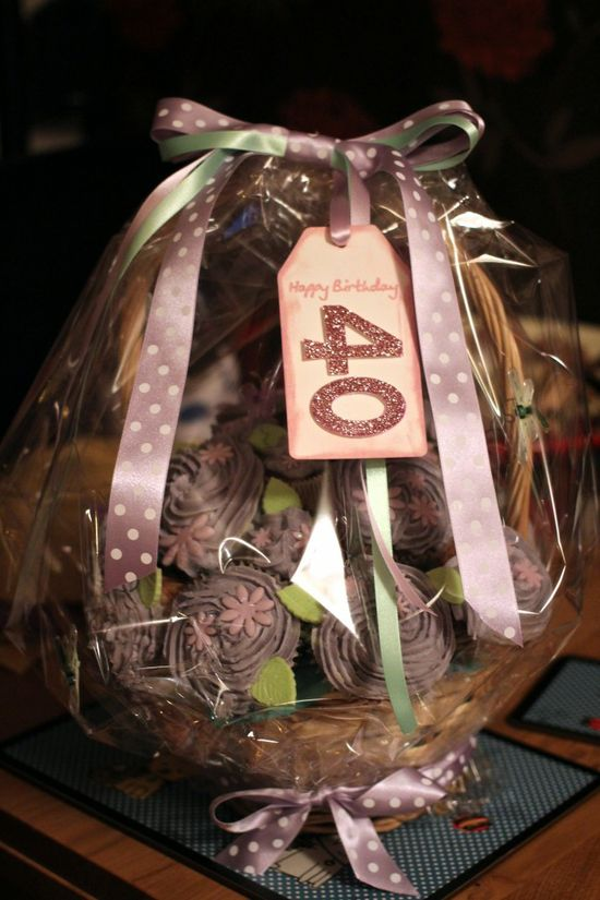 Country basket themed cupcake bouquet made for a 40th birthday present and wrapped in florist paper with handmade label