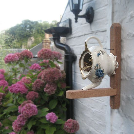 teapot as birdhouse. I will add another birdhouse tomorrow!