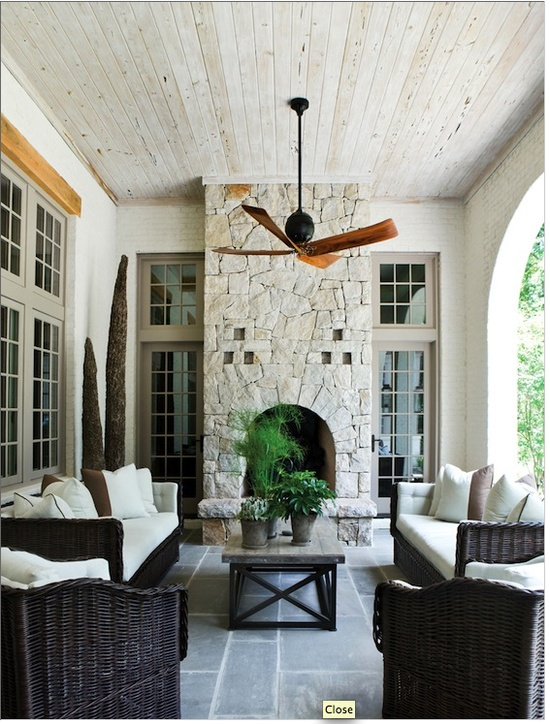 Outdoor spaces via Atlanta homes and lifestyles -- love it all, floor, pickled wood ceiling, fireplace stone and opening, colors...