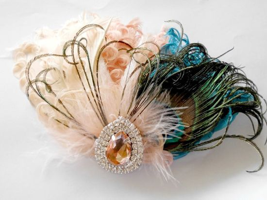 Wedding Feather Hair Accessories Feather by parfaitplumes on Etsy, $35.00 This unique feather hair piece blends teal, peach and ivory Nagoire feathers with a large natural peacock plume. The piece is accented with a downy soft cluster of peach Maribou and curled peacock herl wisps. Emu plumes and biots in ivory also feature.The central jewel is encrusted with clear Czech rhinestones and a large central peach teardrop rhinestone. Measures 4 X 5&1/2 inches.
