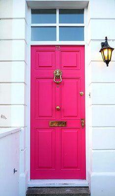 Bright pink front door.