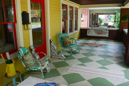 After seeing this I am going to have to make some pillows to put in the old metal chairs on my front porch!  I'm really wanting a porch swing out there, too and having that rug by the swing is just too cute!