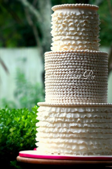3 tier ivory wedding cake was decorated with handmade pearls and frills