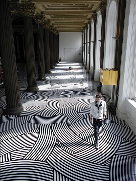 Bold geometric tape flooring.