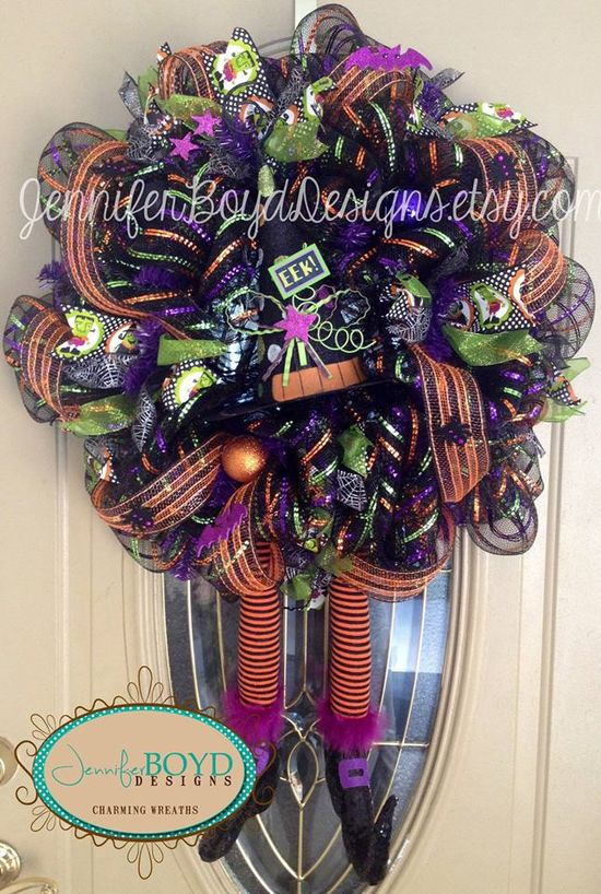 Another beautiful Halloween wreath by Jennifer Boyd Designs. www.etsy.com/...  Witches legs an witch hat both purchased at www.trendytree.com. #trendytree #halloween