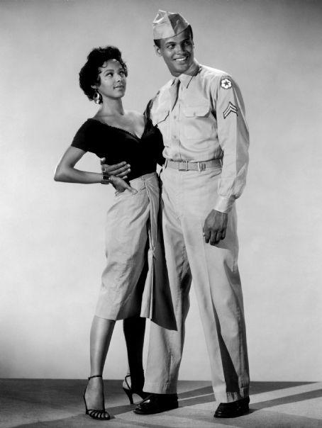 "Dorothy Dandridge and Harry Belafonte, ""Carmen Jones"" (1954), a contemporary version of Bizet's opera, ""Carmen,"" with new lyrics and an African-American cast."